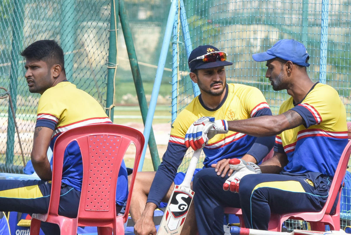 Karnataka skipper Manish Pandey (centre), team-mates K Gowtham (left) and A Mithun during a practice session ahead of their Ranji Trophy quarterfinal against Rajasthan at the M Chinnaswamy Stadium in Bengaluru on Monday. DH Photo/ S K Dinesh
