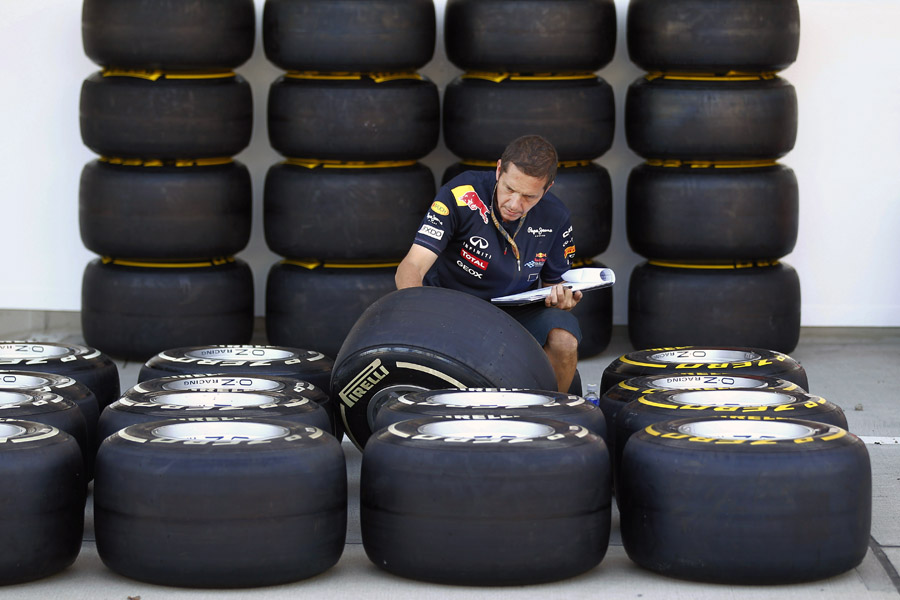 A mechanic checking a batch of tyres. Picture credit: Pirelli