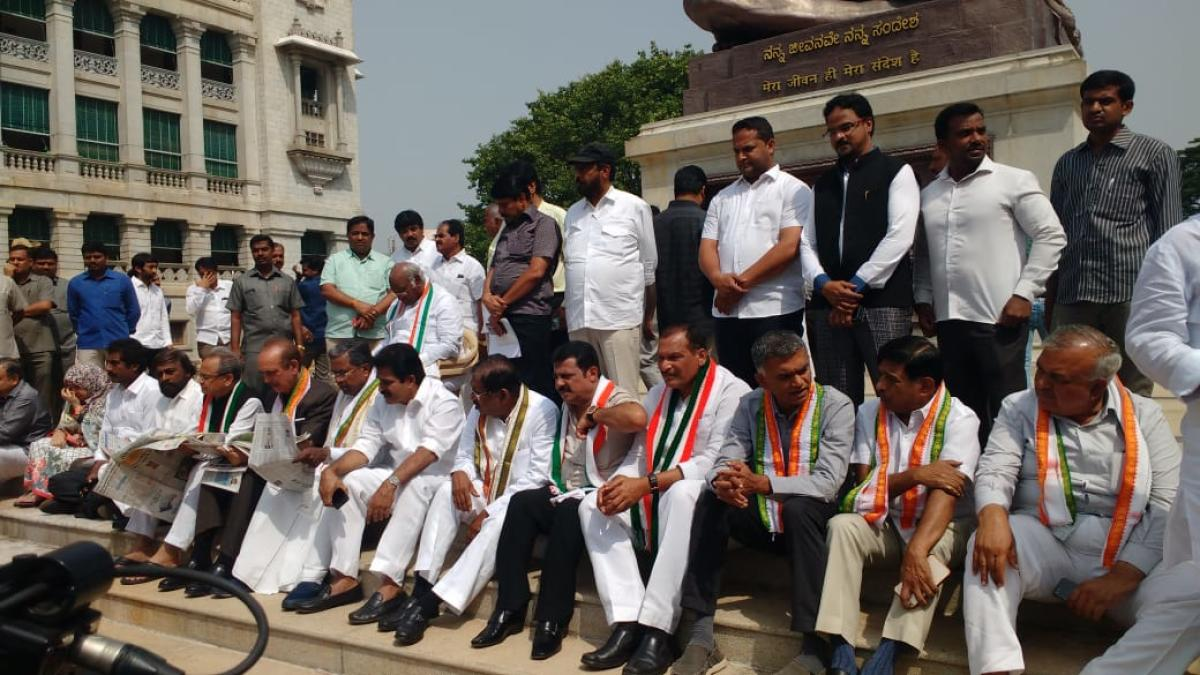 Congress leaders stage protest in front of Vidhana Soudha.