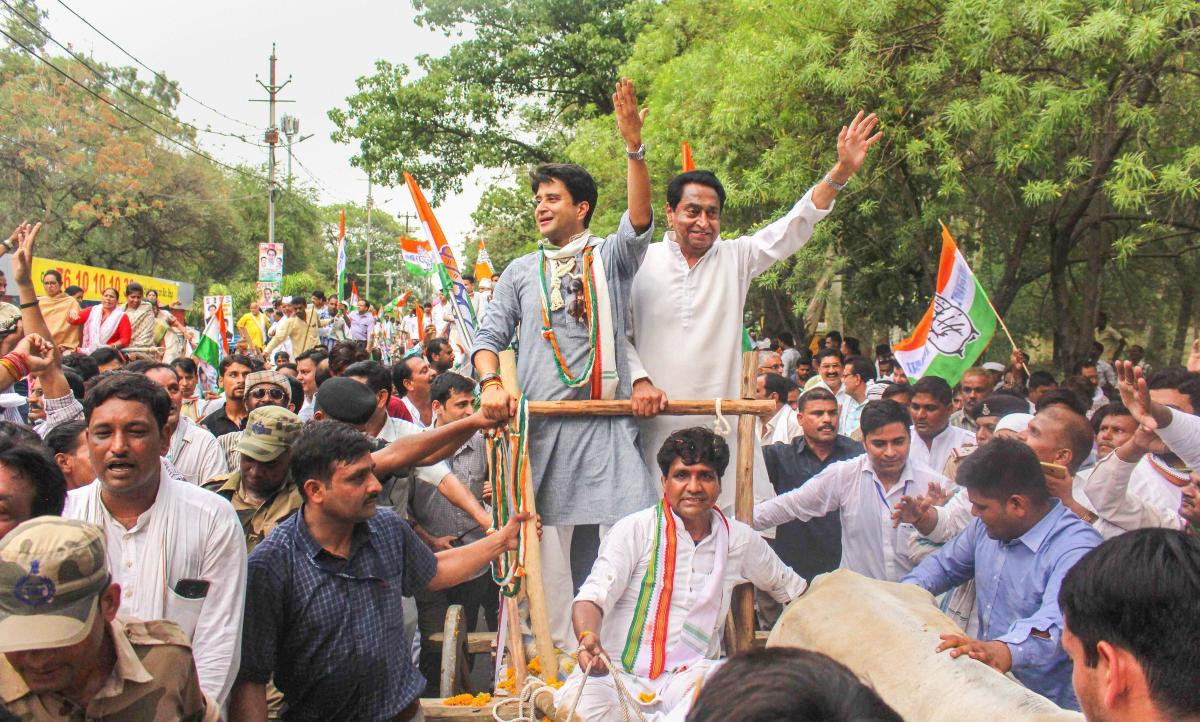 State Congress president Kamal Nath and chairman of Madhya Pradesh election campaign committee Jyotiraditya Scindia ride on bullock cart during a protest rally against the fuel price hike, in Bhopal on June 05, 2018. PTI