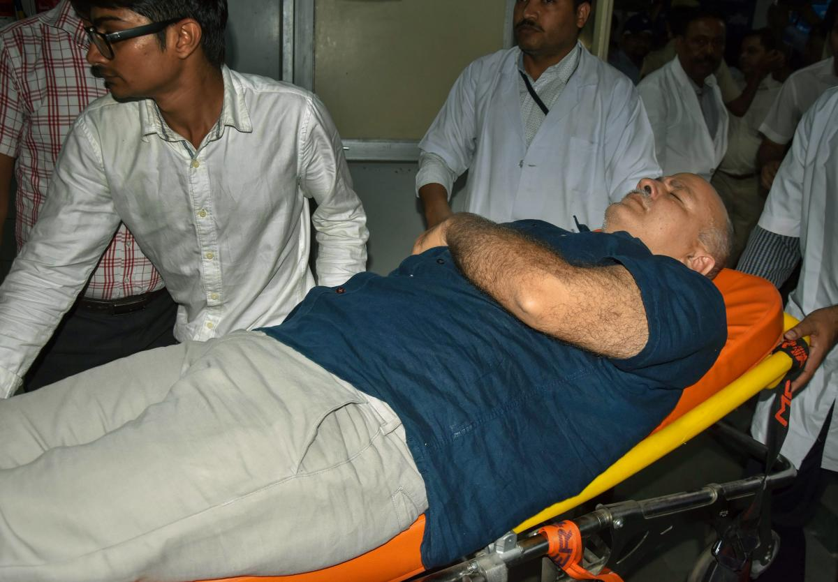 Deputy Chief Minister Manish Sisodia, who was on a hunger strike at Lt Governor's residence, being hospitalized at LNJP Hospital in New Delhi on Monday. PTI.
