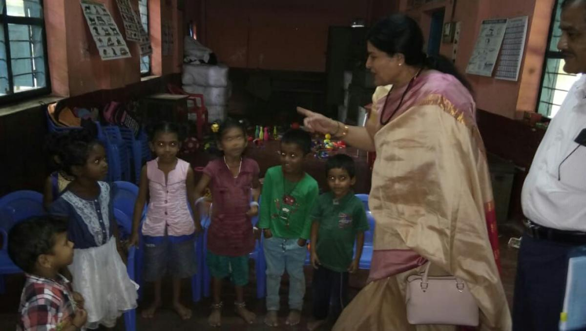 Minister Jayamala interacts with kids at Bijai Kapikad anganwadi.