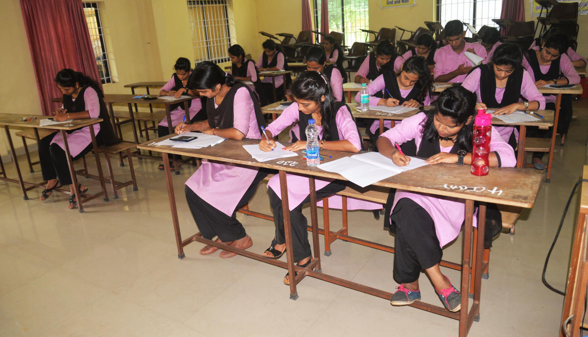Students of Crossland College, Brahmavar, write a college examination without an invigilator.