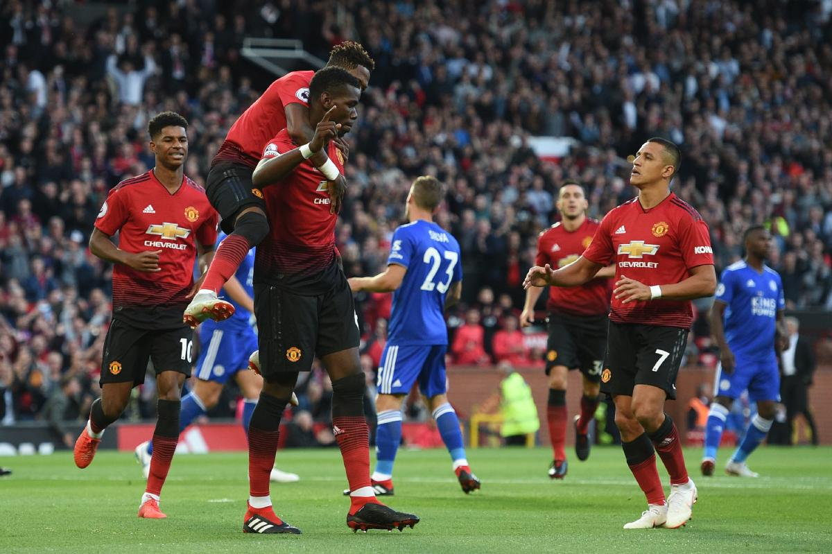 DELIGHTED: Manchester United's Paul Pogba (centre) celebrates with team-mates Fred (left) and Alexis Sanchez after scoring the opening goal. AFP