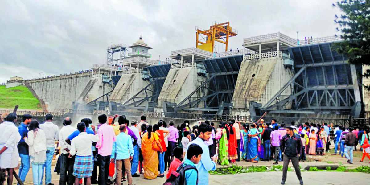 Tourists near the Kabini dam at Beechanahalli in HD Kote taluk as crest gates were opened on Saturday.