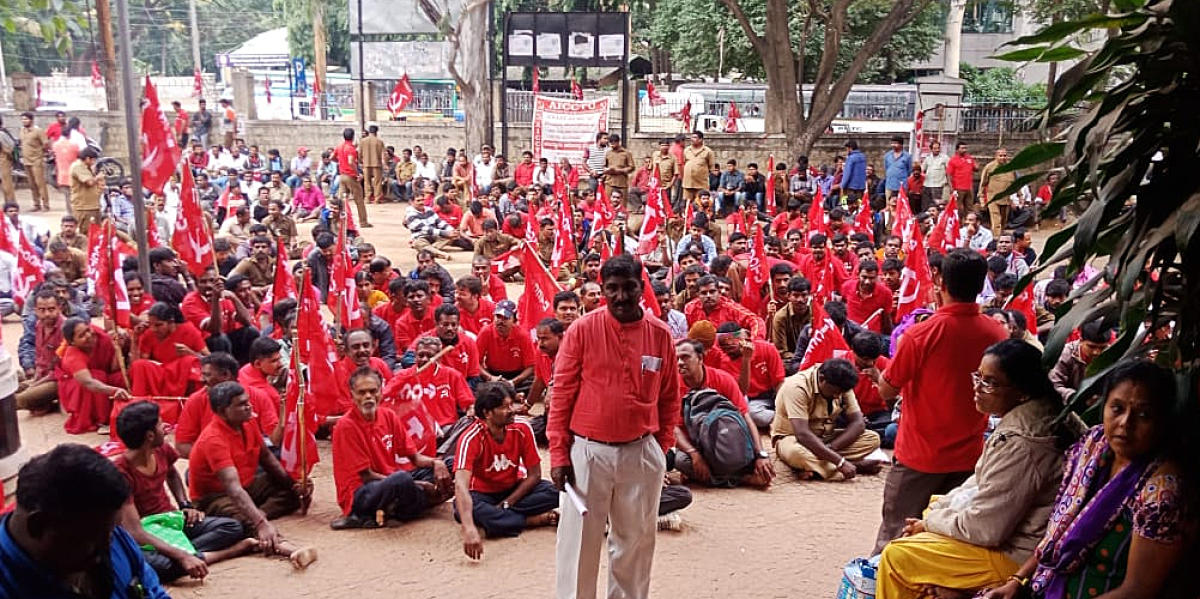 Members of the BWSSB union protest againt to demand menimum wages and job security infront of the labor commissioner office in Bengaluru on Monday.