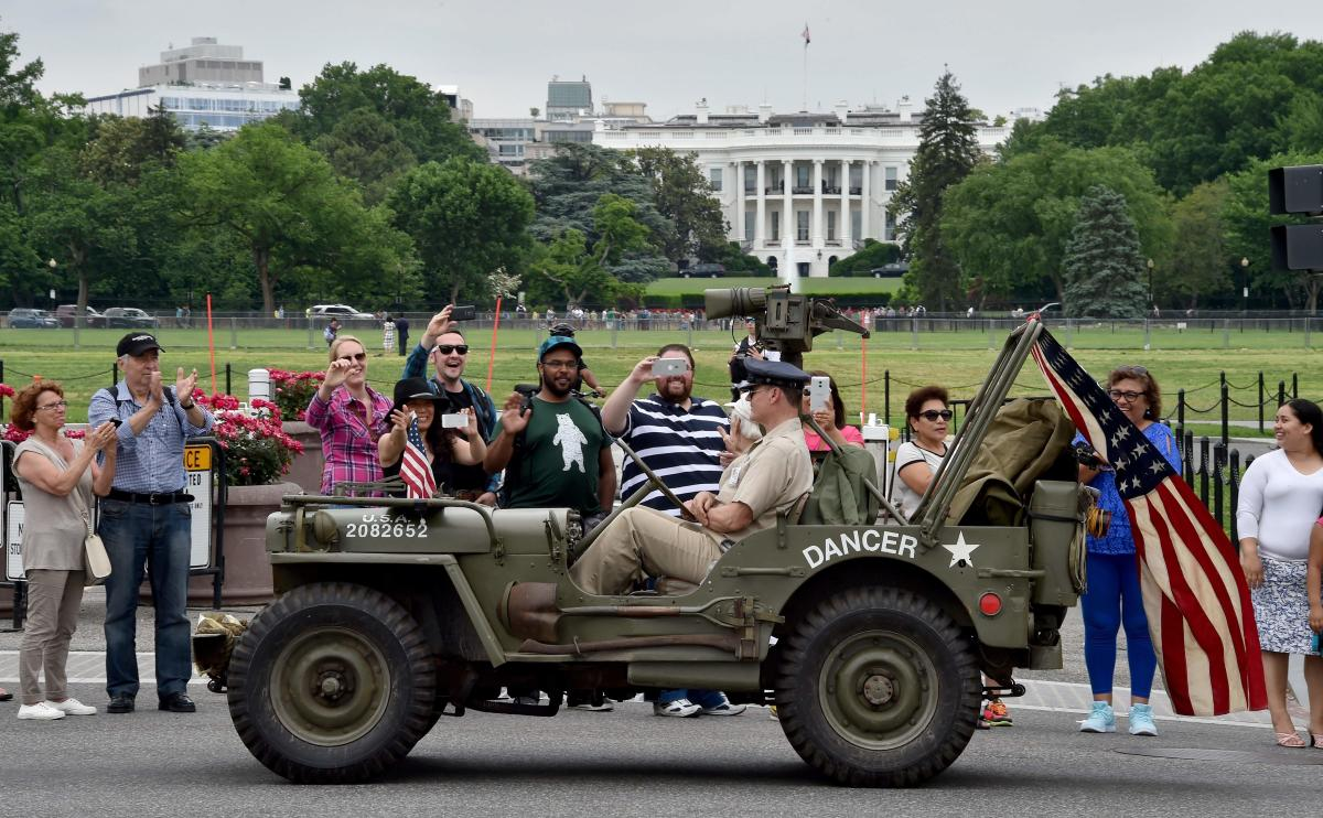 In this file photo taken on May 30, 2016, participants ride a WWII Jeep in front of the White House during the Memorial Day Parade on Constitution Avenue in Washington, DC. AFP