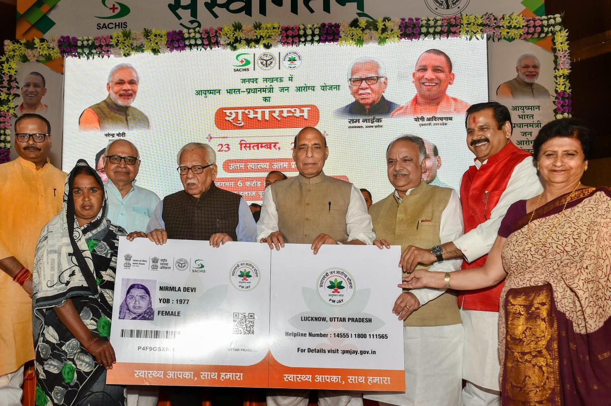 Union Home Minister Rajnath Singh flanked by UP Governor Ram Naik (L) and UP Assembly Speaker Hriday Narayan Dixit at the launch of Ayushman Bharat-National Health Protection Mission (AB-NHPM), in Lucknow. PTI