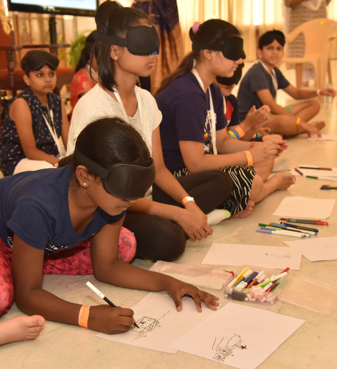 Children to get involved in activities by without seeing after performed prjna yoga at Art of Living in Bengaluru on Tuesday, 2nd October 2018. (DH Photo/Janardhan B K)