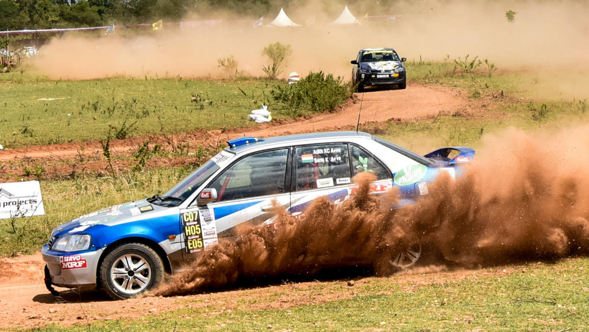 A driver negotiates a carve at the Mysuru Dasara Gravel Fest, a dirt track race, at Lalith Mahal helipad grounds in Mysuru on Sunday. DH PHOTO