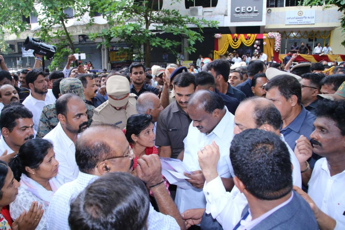 Chief Minister H D Kumaraswamy receives complaints from the people in Mangaluru on Sunday.