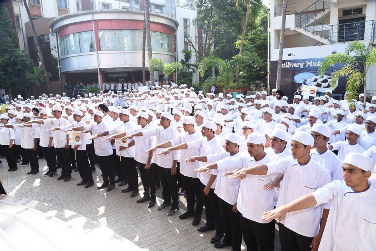 Students of Welcomgroup Graduate School of Hotel Administration take an oath as a part of International Chefs Day in Manipal.