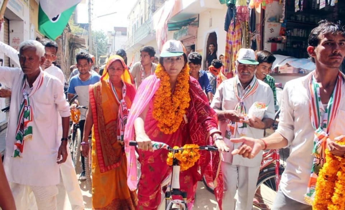Rukshmani Kumari, an ex-royal and Rajasthan AIPC president takes cycle ride to reach villages in the Chomu constituency.