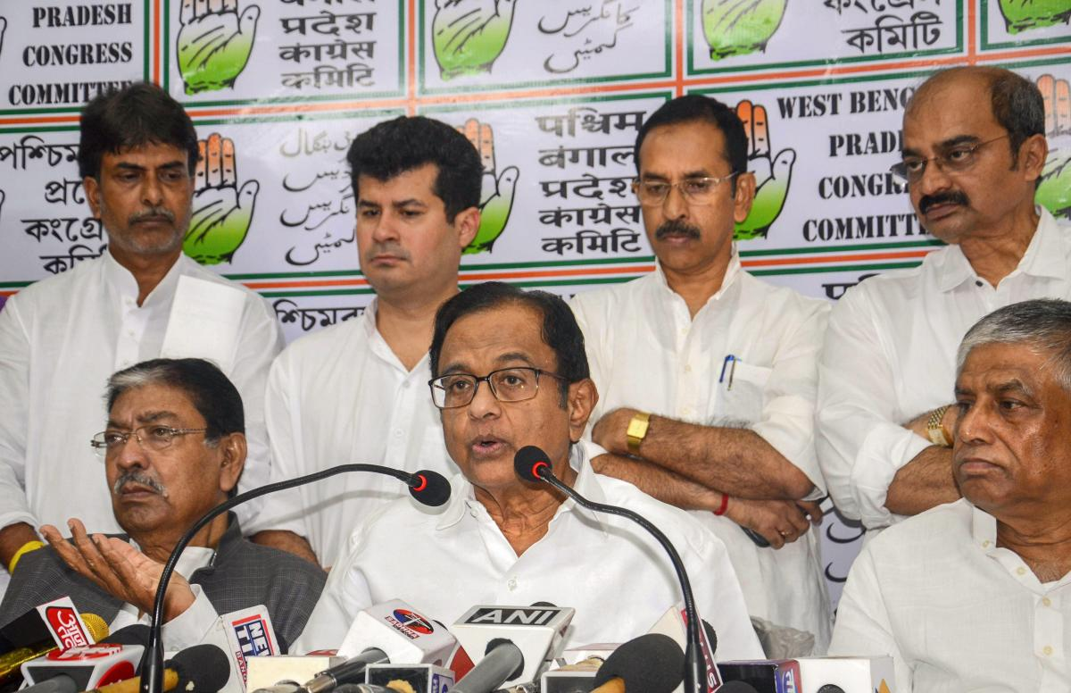 Senior Congress leader and former finance minister P Chidambaram addresses a press conference on the second anniversary of demonetisation at West Bengal Pradesh Congress head office, in Kolkata, on Thursday. Bengal Congress president Somen Mitra is also s