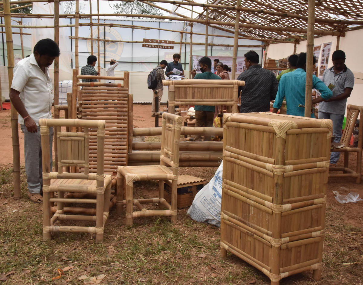 Visitors at a stall with bamboo products at the Krishi Mela.