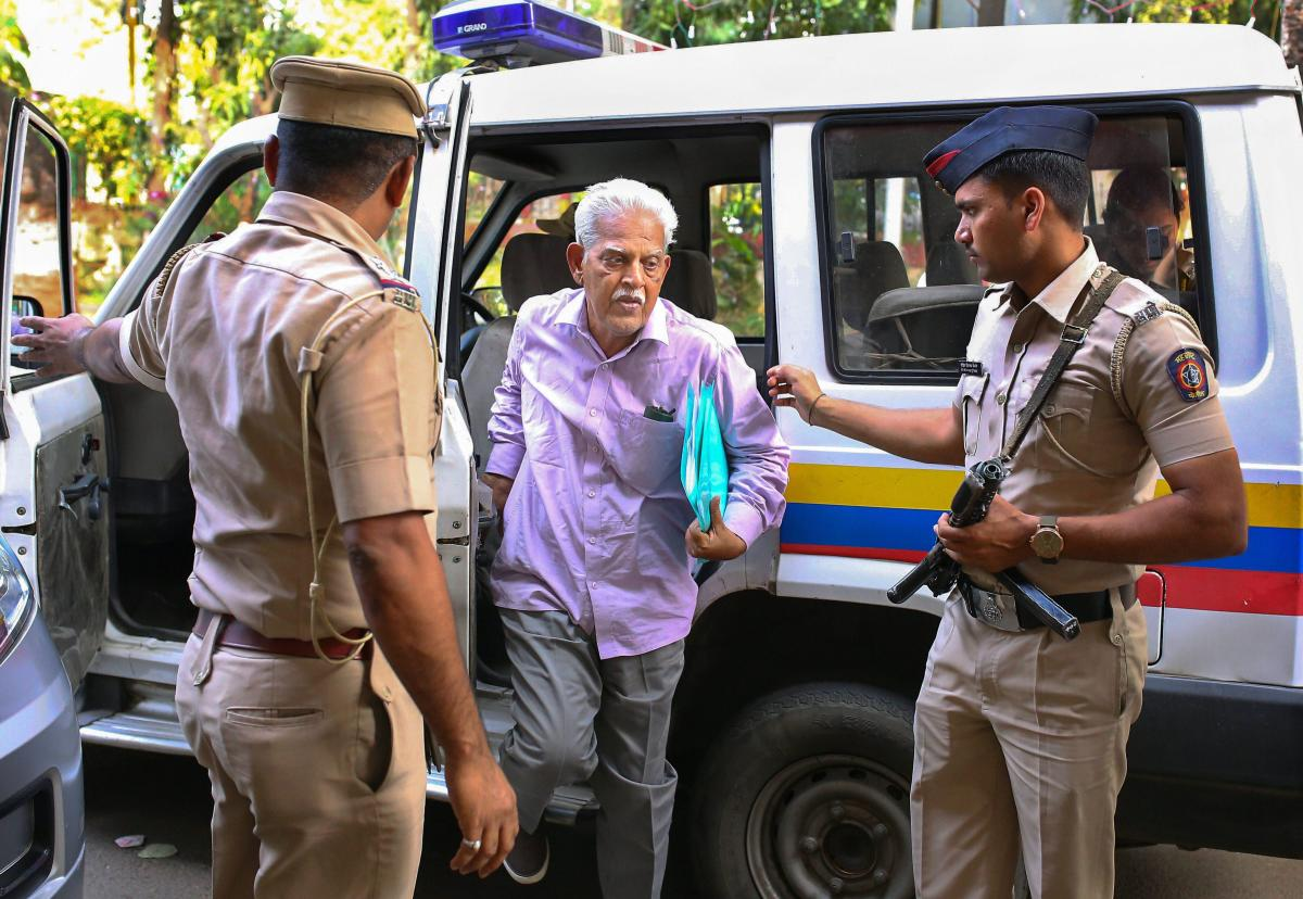 Activist/writer and poet P Varavara Rao, arrested in connection with Elgar Parishad case, at Lashkar Police Station in Pune on Sunday. PTI