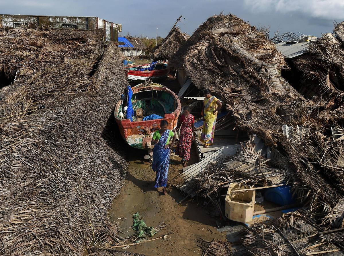 People survey the damage caused by cyclone Gaja in their vicinity, at Kodiakkarai in Nagapattinam district. PTI