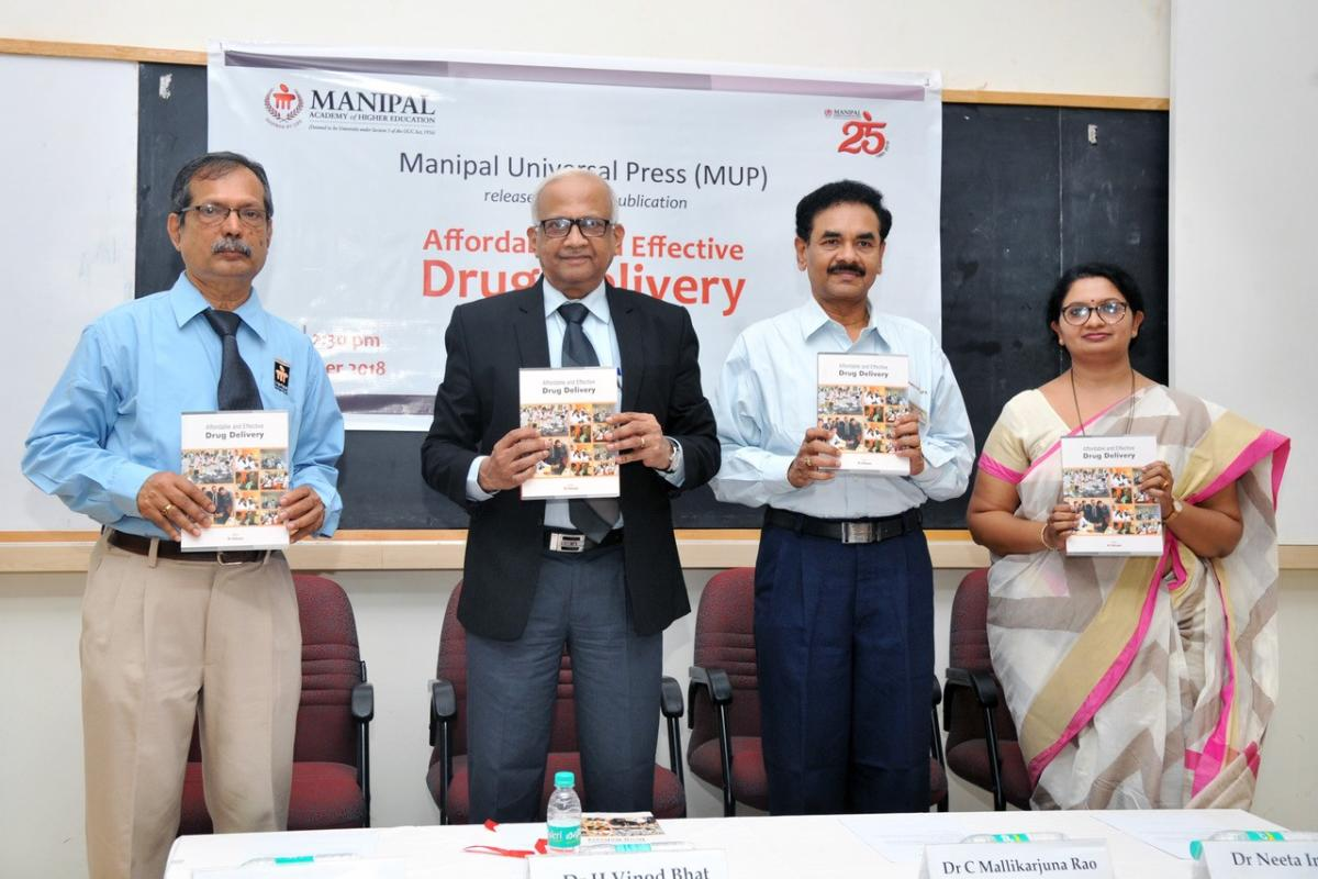 MAHE Vice Chancellor Dr H Vinod Bhat (2nd from left) releases a book on drug delivery.