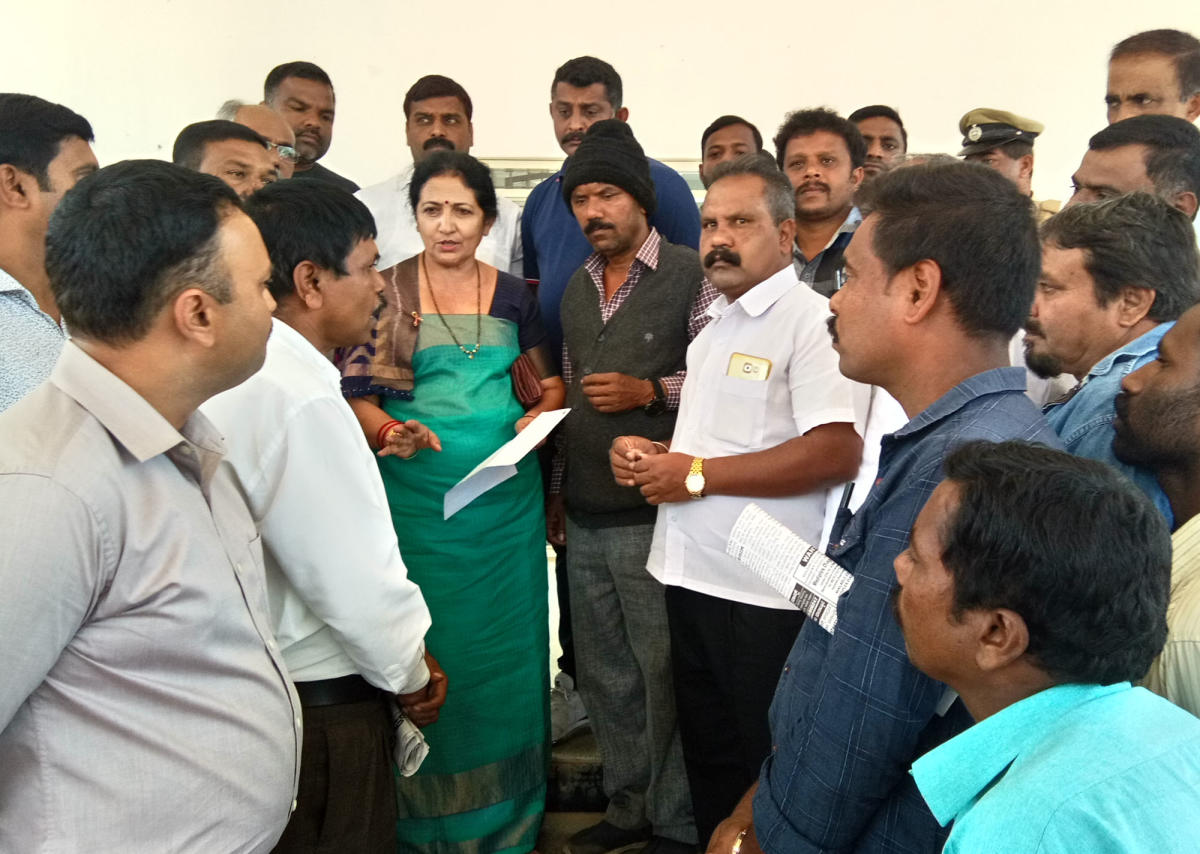 MLC Veena Acchaiah speaks to the protesters who were staging a dharna under the aegis of Dalita Sangharsha Samiti, in front of the Mini Vidhana Soudha in Virajpet on Sunday.