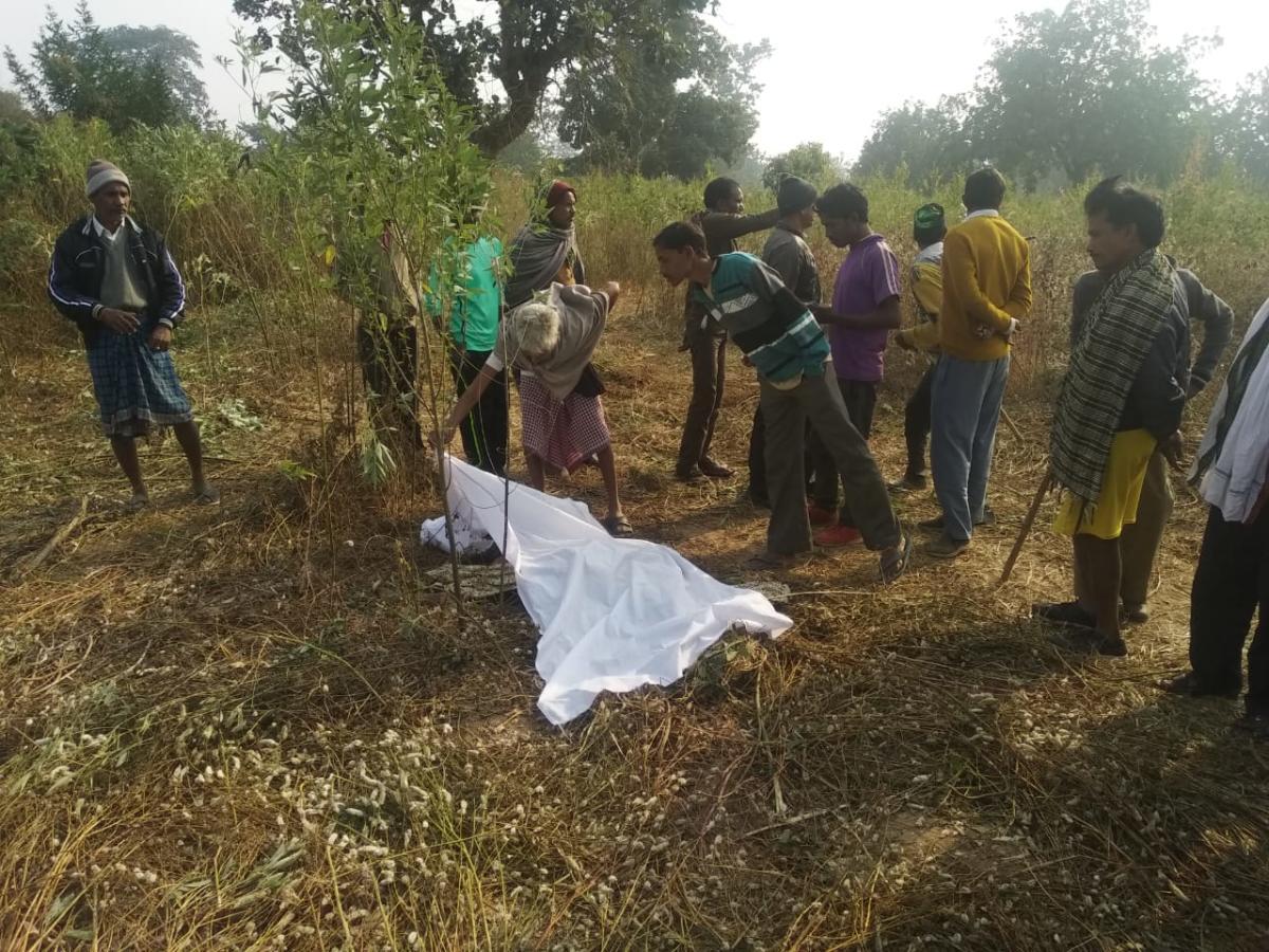 Villagers surround dead farmer Dev Kumar.