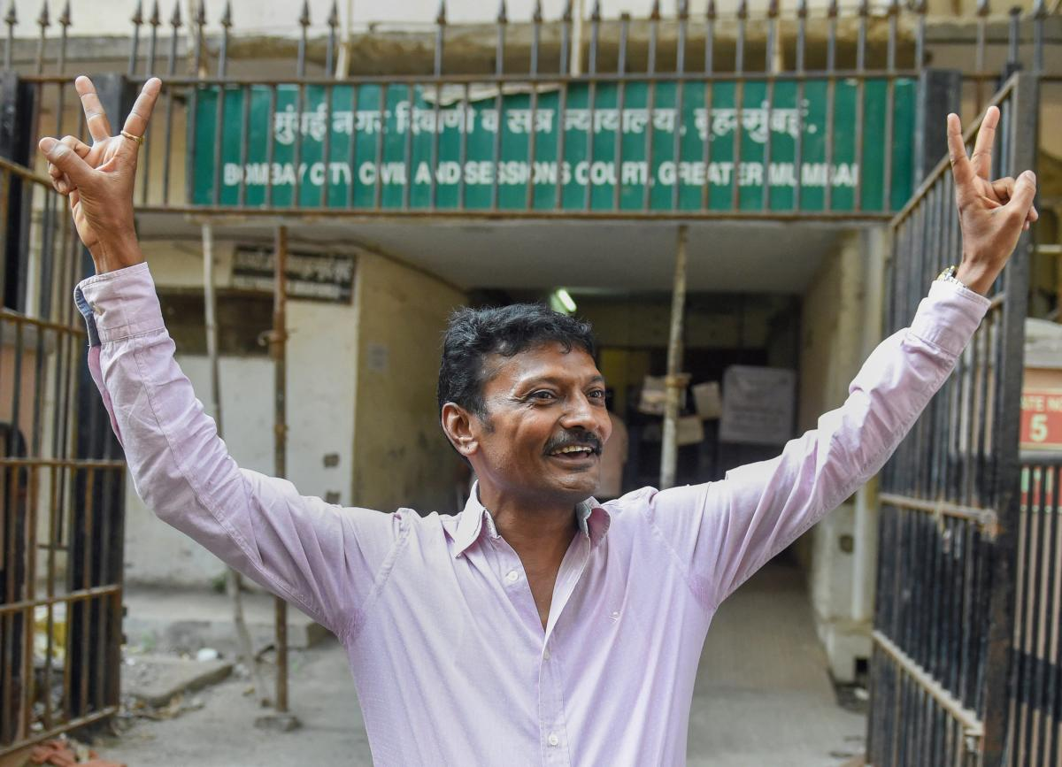 Rajendra Jeerawala, owner of a farm house in Gujarat who, according to CBI, facilitated the illegal detention, leaves the special CBI court after he was acquitted, in Mumbai, Friday, Dec. 21, 2018. The court has acquitted all 22 accused in the alleged fak