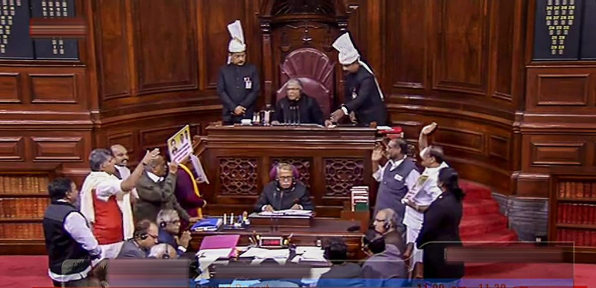 New Delhi: Members protest in the well of the Rajya Sabha in New Delhi, Monday. RSTV grab/ PTI Photo
