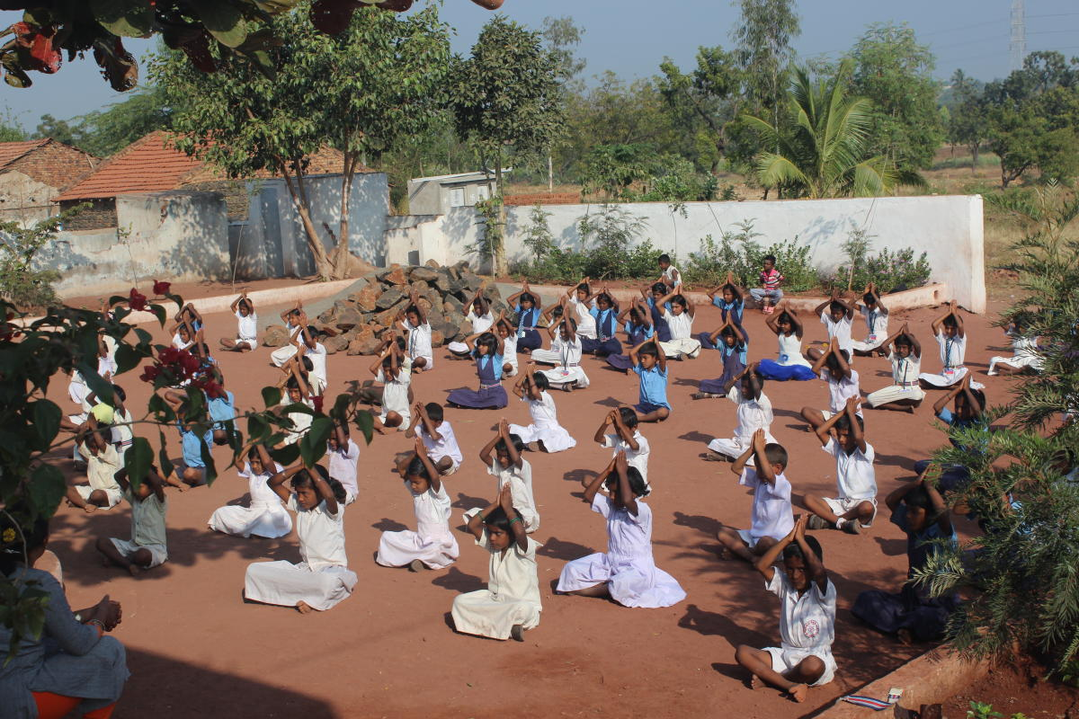 Alive and kicking: Mass drill by school students in the renovated school premises; well-furnished classrooms; front exterior view of the school.