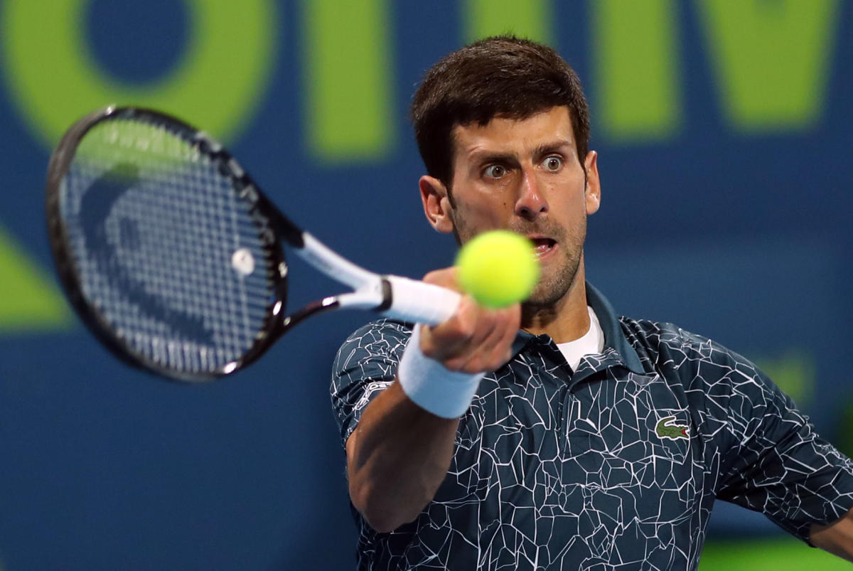 Novak Djokovic of Serbia returns the ball to Roberto Bautista Agut of Spain during their ATP Qatar Open tennis semi-final match in Doha on January 4, 2019. (AFP Photo)