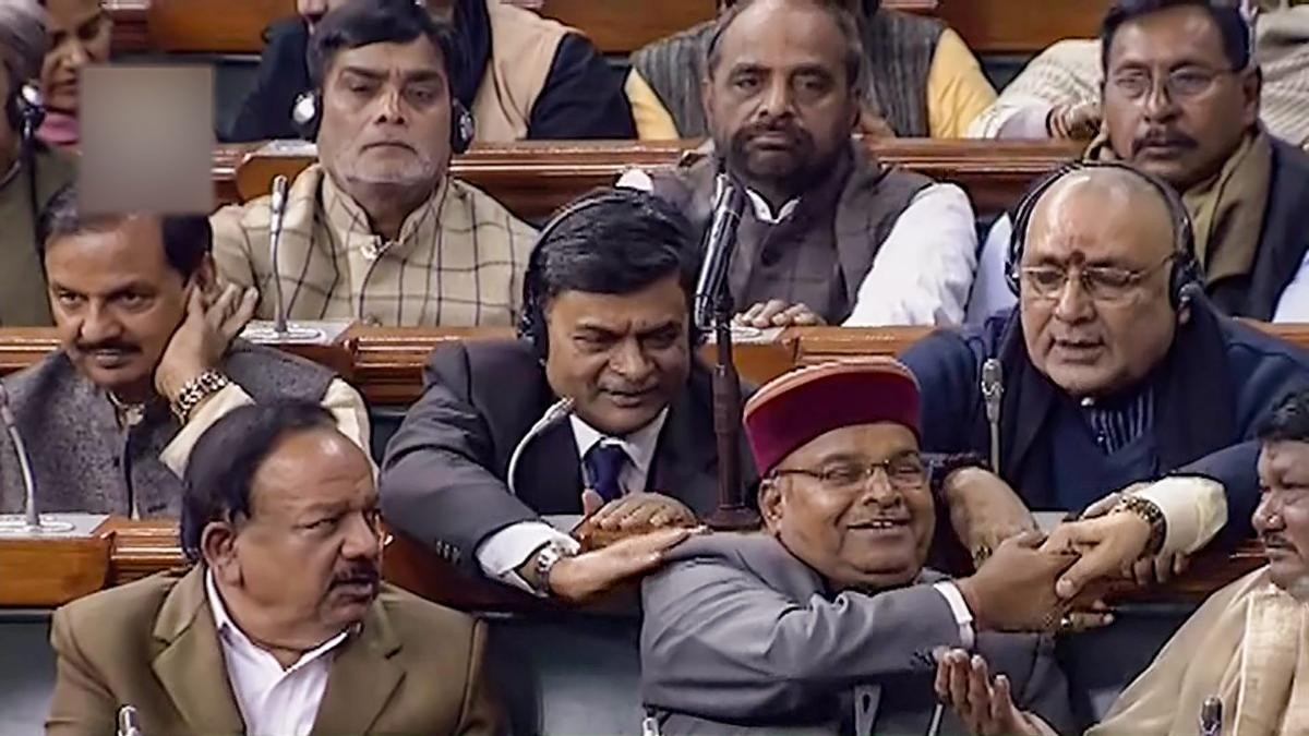 Social Justice Minister Thawarchand Gehlot and other MPS after Lok Sabha passes the bill to provide 10 per cent reservation in jobs and educational institutions to economically backward section in the general category, in Lok Sabha in New Delhi, Tuesday,