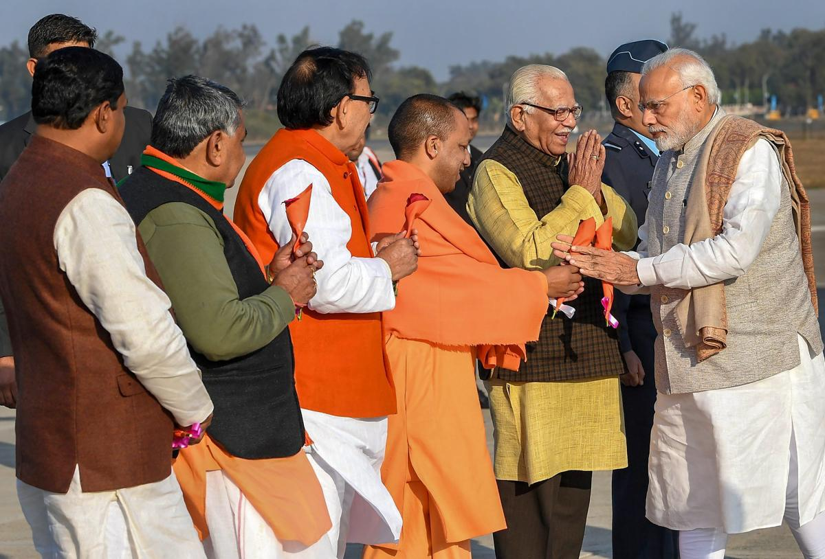 Prime Minister Narendra Modi being received by Uttar Pradesh Governor Ram Naik, state Chief Minister Yogi Adityanath and others on his arrival, in Agra, Wednesday, Jan 9, 2019. PTI