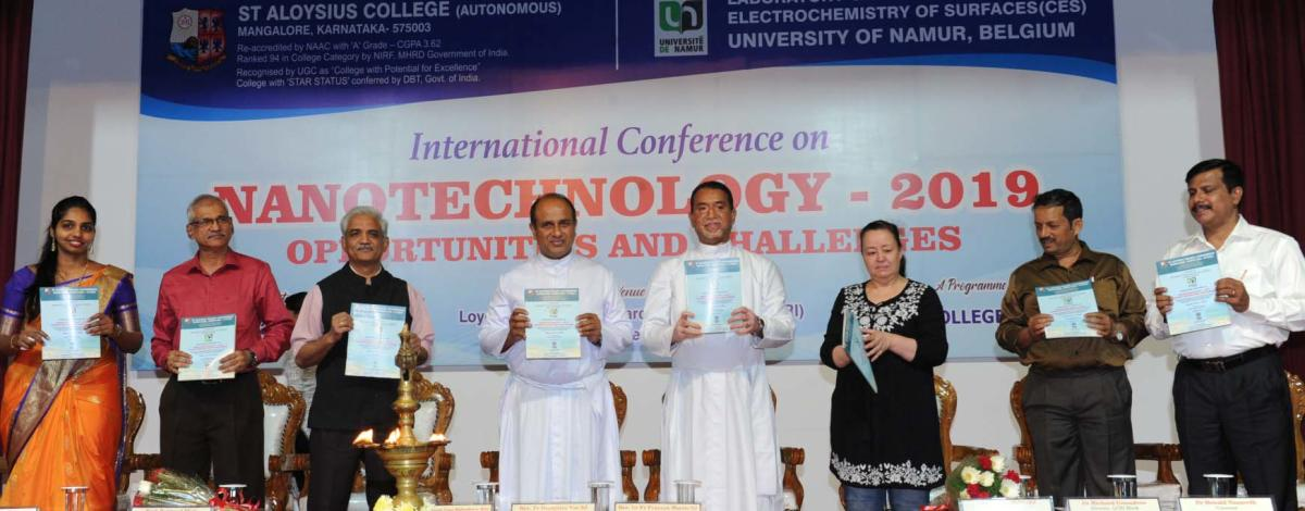 St Aloysius College Principal Fr Praveen Martis releases the book of abstracts at the two-day international conference on nanotechnology organised at L F Rasquinha Hall of St Aloysius College on Thursday.