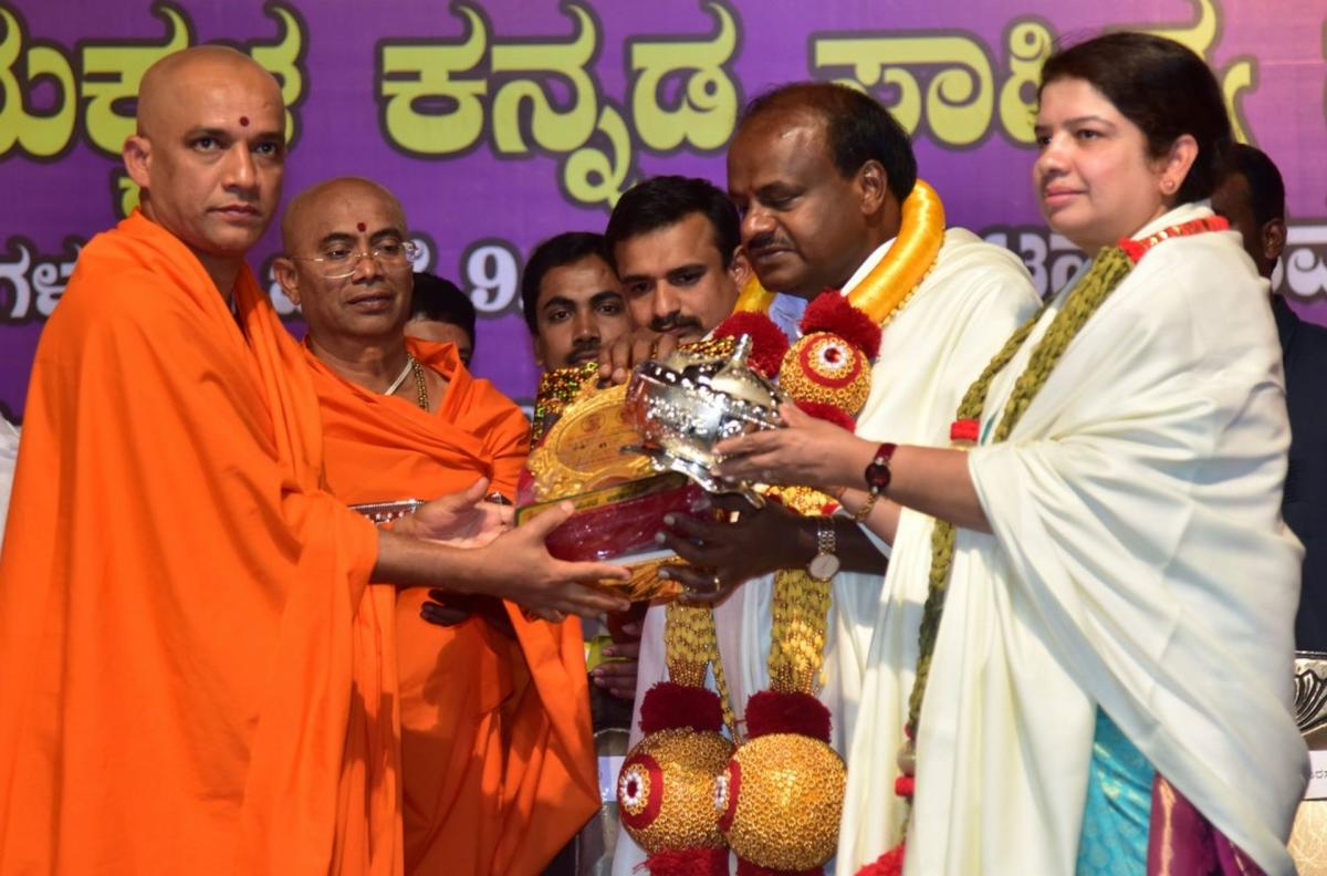 Adichunchanagiri seer Nirmalanandanatha Swami felicitates Chief Minister H D Kumaraswamy and his wife, Ramanagara MLA, Anitha Kumaraswamy, during a programme, at the mutt in Nagamangala taluk, Mandya district on Friday. dh photo