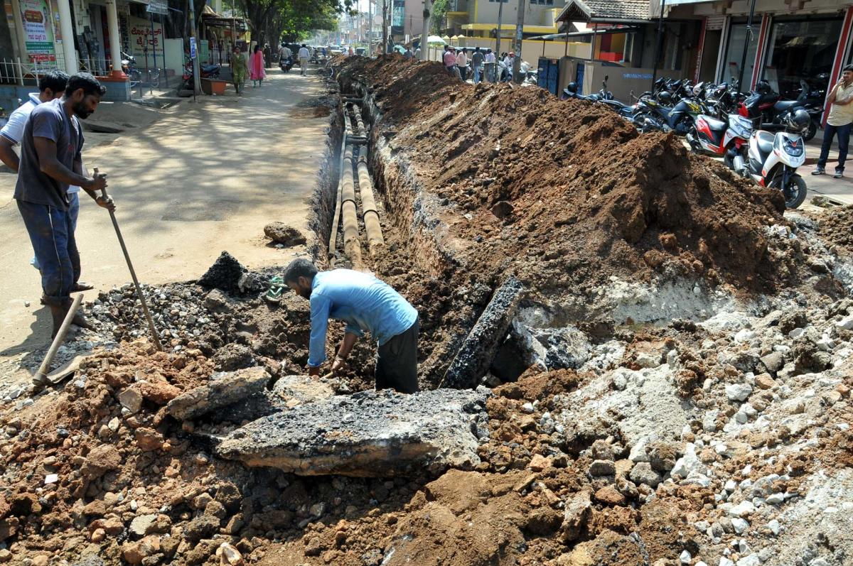 The work on laying drinking water pipeline in progress on Basavanahalli Main Road in Chikkamagaluru.
