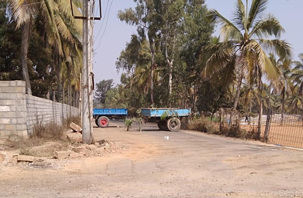 Villagers park tractors on the road to prevent garbage trucks from entering the quarry at Bellahalli in Bengaluru.