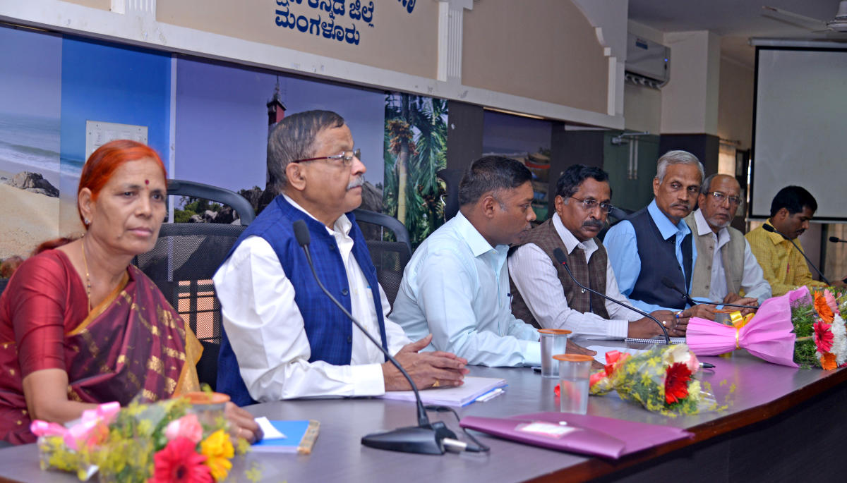 Chairman of State commission for Food and Civil Supplies Dr N Krishnamurthy chairs a meeting in Mangaluru on Saturday.