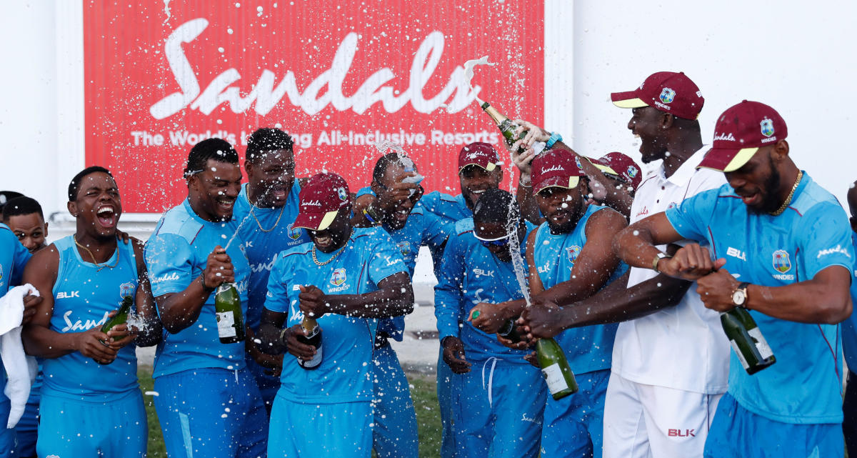 OVER THE MOON West Indies' players celebrate after the winning the series against England in Antigua on Saturday. REUTERS