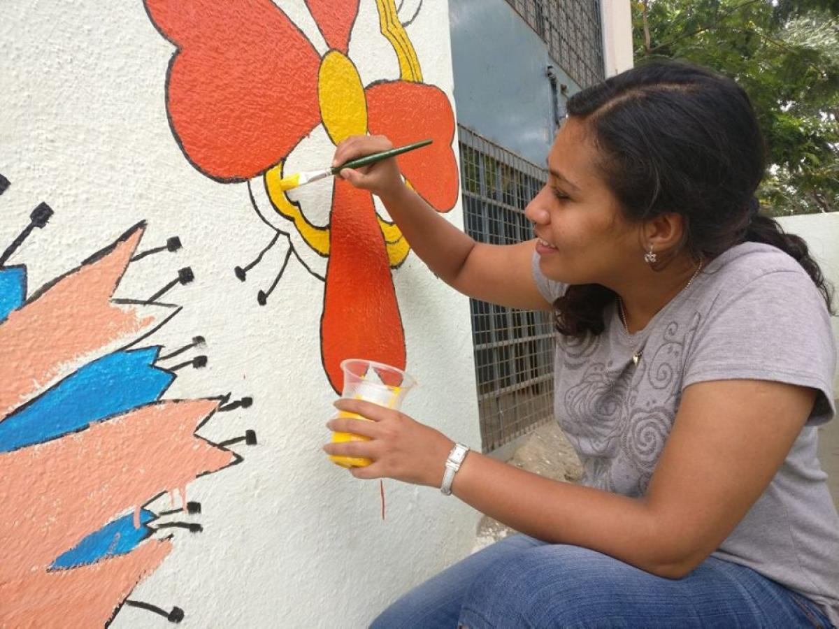 One of the volunteers paints the wall of a children's home in Bengaluru. FACEBOOK