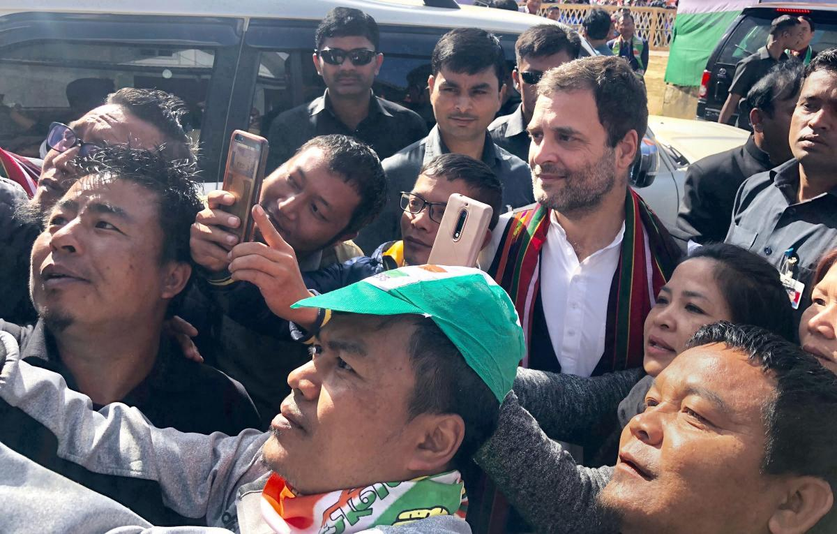 Congress President Rahul Gandhi obliges his supporters for selfies during an election rally in Champai, Mizoram. (PTI Photo)
