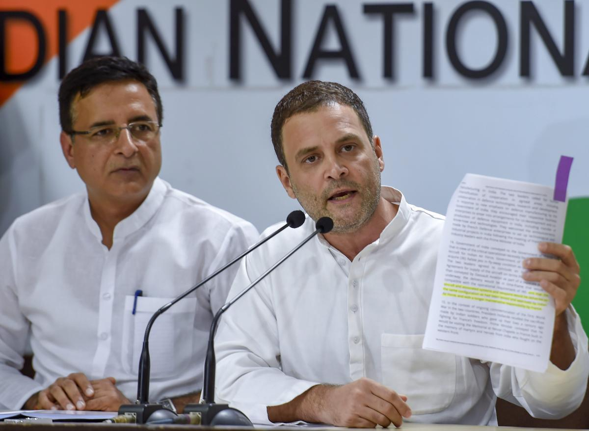 Congress President Rahul Gandhi addresses a press conference in New Delhi on Thursday, August 30, 2018. The party spokesperson Randeep Singh Surjewala is also seen. PTI