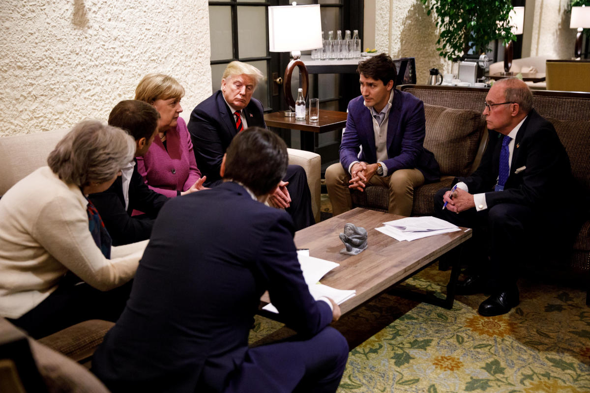 Canada's Prime Minister Justin Trudeau and G7 leaders France's President Emmanuel Macron, Germany's Chancellor Angela Merkel, Britain's Prime Minister Theresa May and U.S. President Donald Trump hold a meeting with staff on the first day of the G7 meeting in Charlevoix city of La Malbaie, Quebec. Reuters.