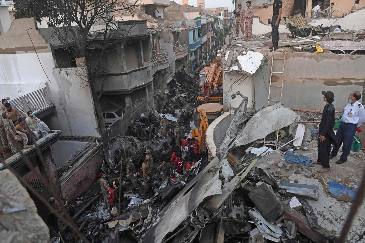 Bodies From The Sky Horror As Plane Crashes Among Homes In Pakistan Deccan Herald