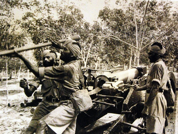 Indian gunners in training with field artillery in Singapore.