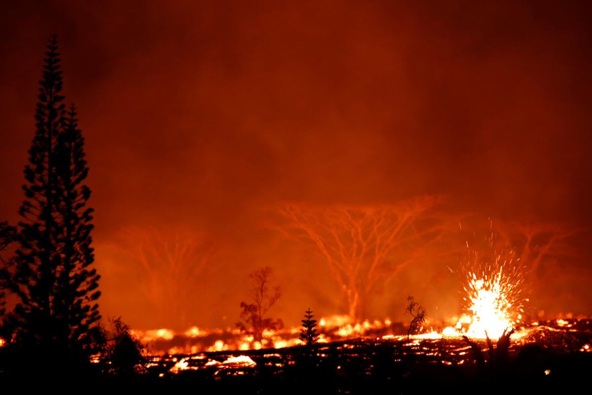 Lava erupts on the outskirts of Pahoa during ongoing eruptions of the Kilauea Volcano in Hawaii, U.S., May 18, 2018. REUTERS