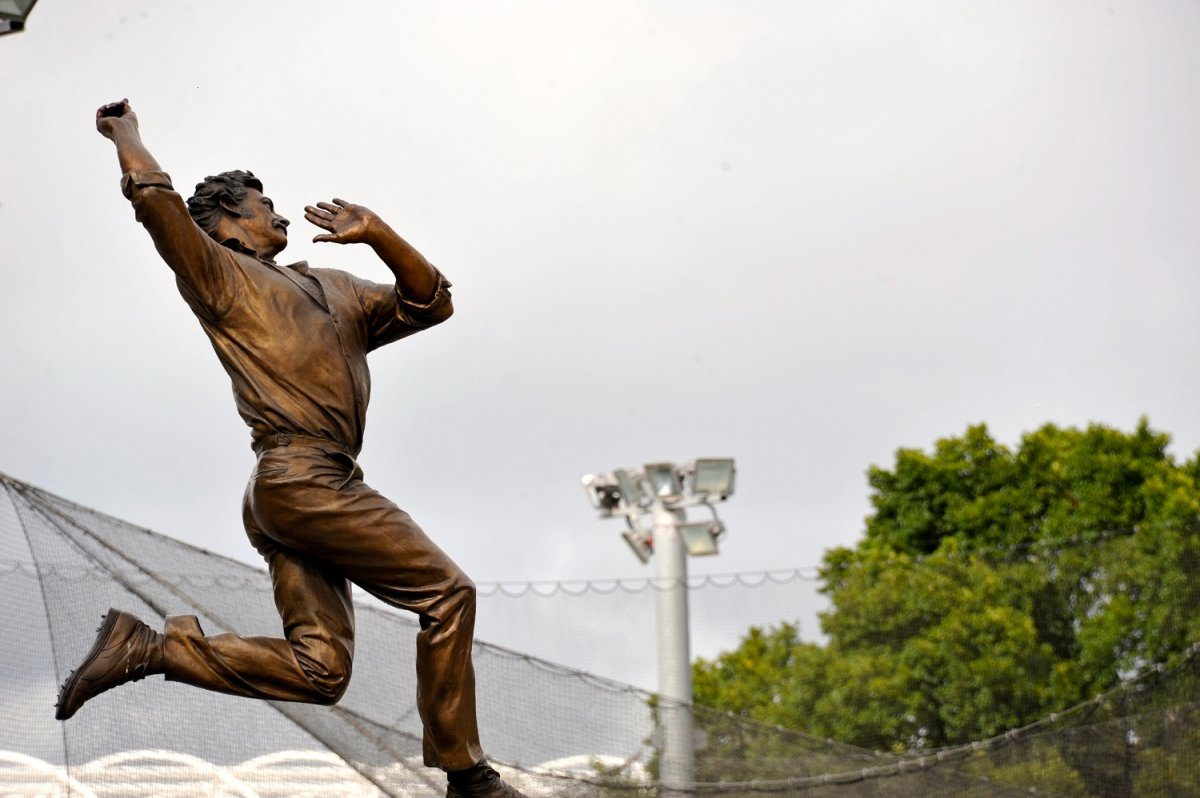 A statue of cricketer Dennis Lillee outside Melbourne Cricket Ground