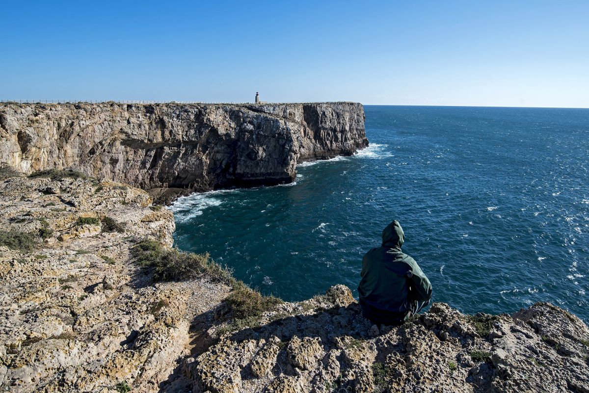 Portugal Sagres - fisherman on the edge of the wind swept cliffs of the 16th century fort built by Dom Henry the Navigator