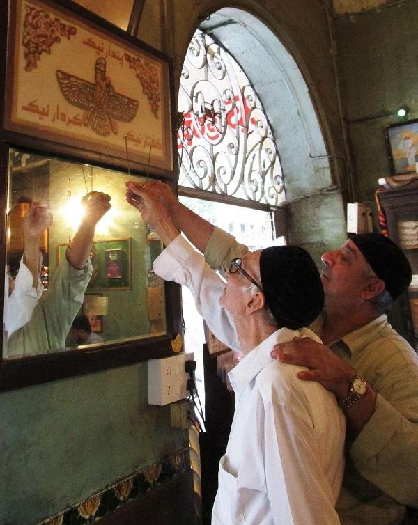 Senior Zoroastrian late Aqa  Boman Kohinoor and his son  Afshin pray with benzoin  incense. PHOTOS BY AUTHOR