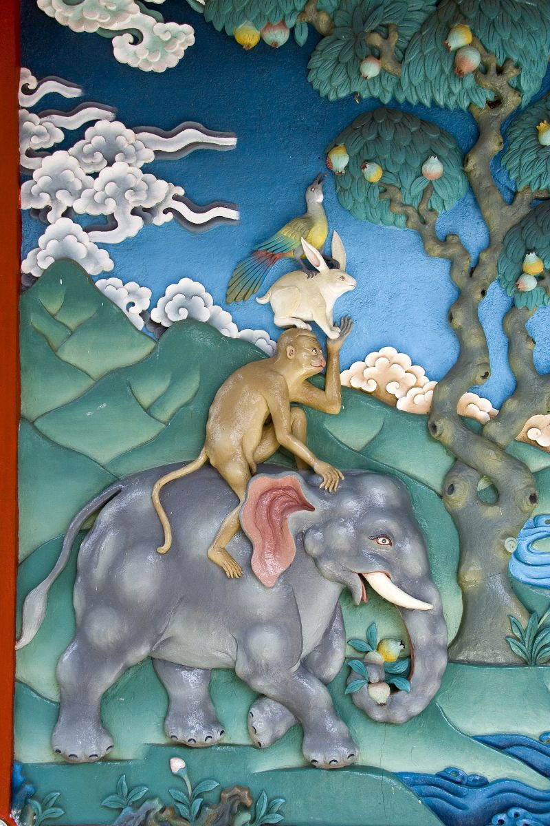 Wall painting depicting interesting story of peacock upon rabbit, upon monkey, upon elephant at Namdroling Monastery, Bylakuppe