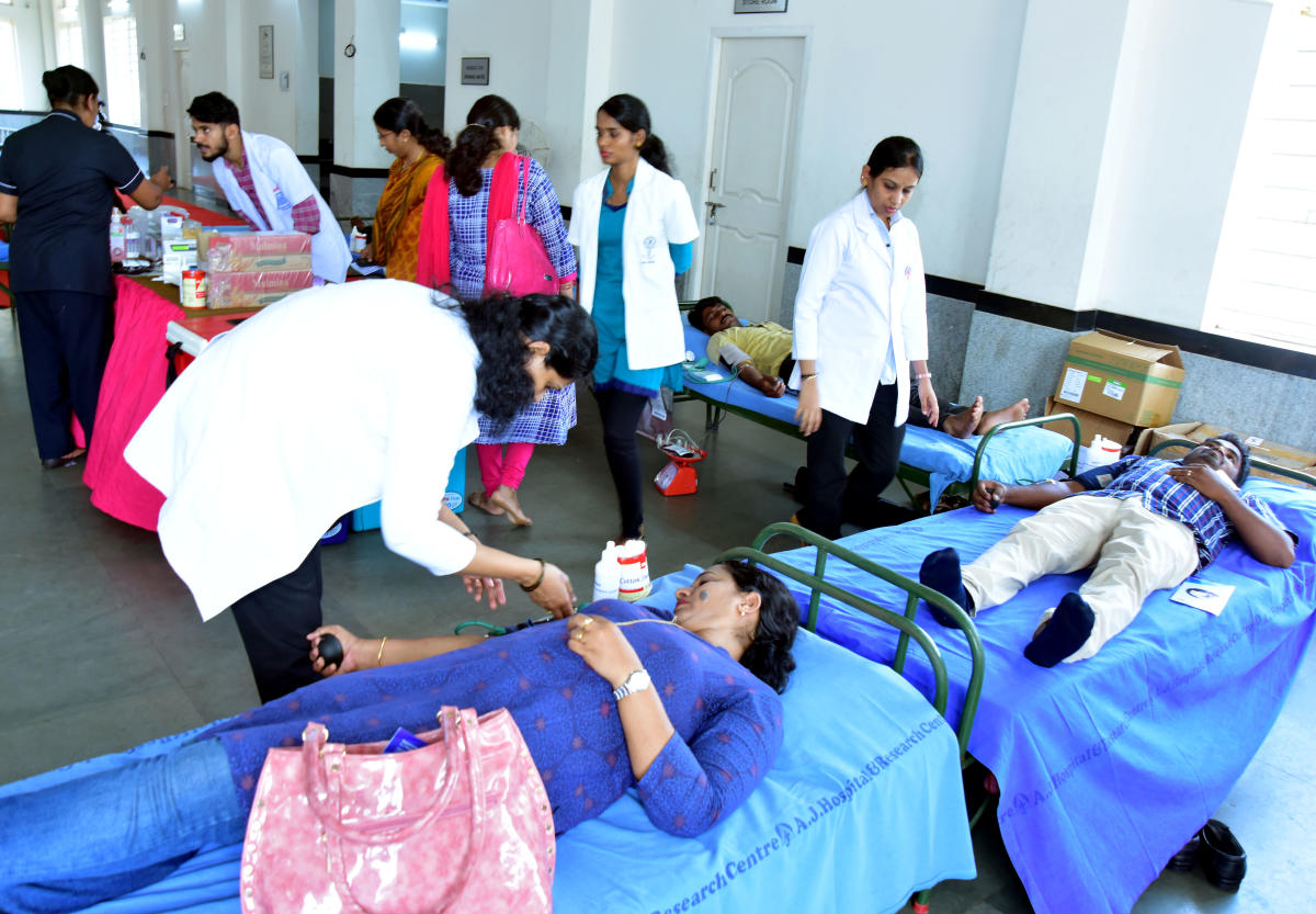 Members of Karnataka State Government NPS Employees' Union Mangaluru unit donate blood at Mini Town Hall in Mangaluru on Wednesday, as a mark of their protest against the National Pension Scheme.