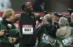 Bolt runs personal best in rain at Paris Golden League