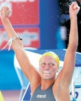 Sjostrom wins 100 butterfly in record time